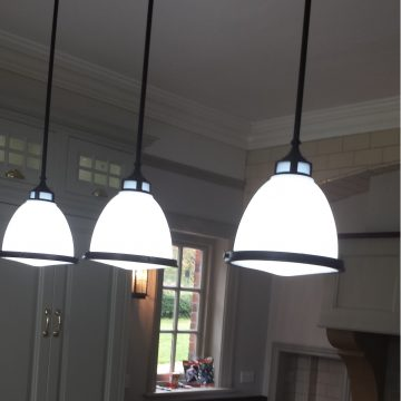 Pendant lights installed above a kitchen island