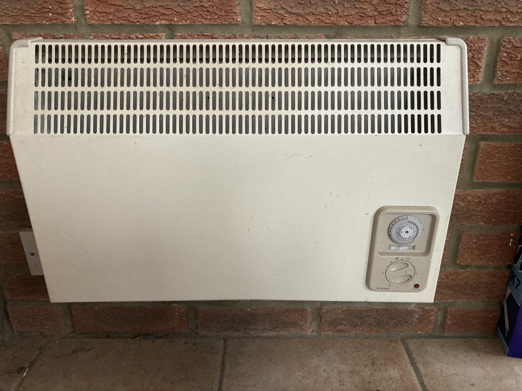 old style inefficient 2000w convector heater replaced by 600w electric radiator